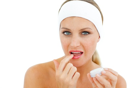balm: Attractive woman applying lip balm  Stock Photo
