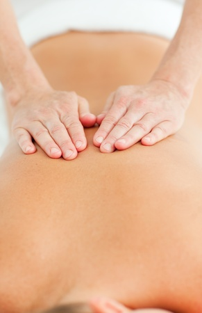 laying on back: Back massage in a spa center