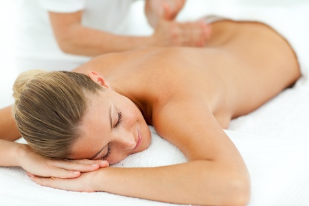 concentrated: Concentrated woman enjoying a massage Stock Photo