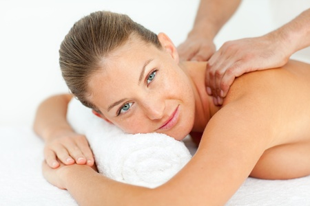 back massage: Calm woman enjoying a massage Stock Photo