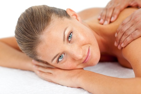 Portrait of blond woman enjoying a massage photo