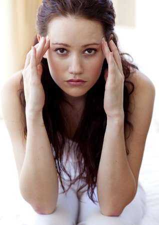 Brunette woman having a headache in bed Stock Photo - 10106668