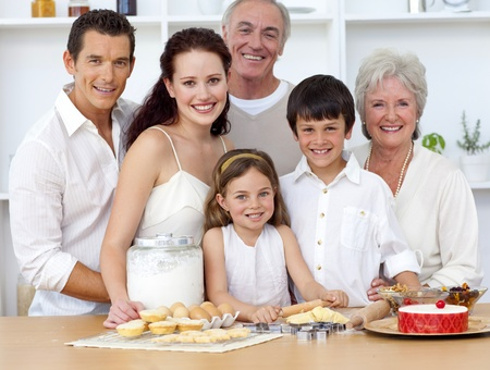 family in kitchen: Big family baking in the kitchen