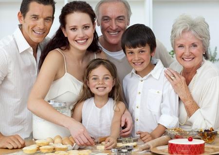 Portrait of parents, grandparents and children baking in the kitchen photo