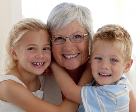 Portrait of grandmother and grandchildren photo