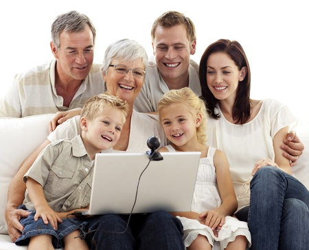 internet love: Happy family in a videoconference Stock Photo