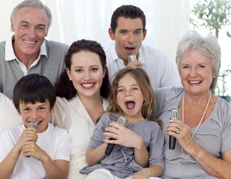 Family singing karaoke at home photo