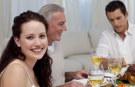 Woman celebrating Christmas dinner with her family photo