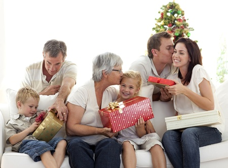 family holidays: Family giving presents for Christmas