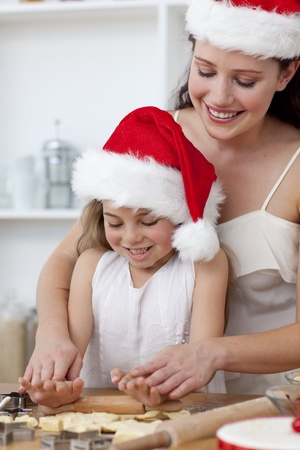 Mother and little girl baking Christmas cakes Stock Photo - 10107407