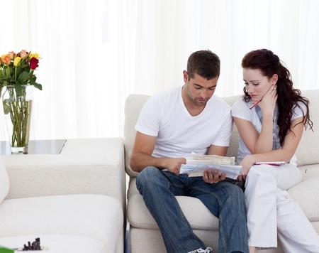 Couple doing their bills photo