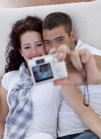 Couple playing with a camera photo