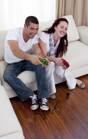 Couple playing video games in living-room photo