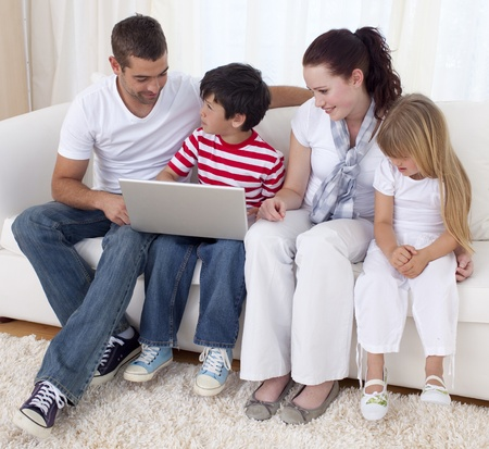 Family at home using a laptop Stock Photo - 10111813