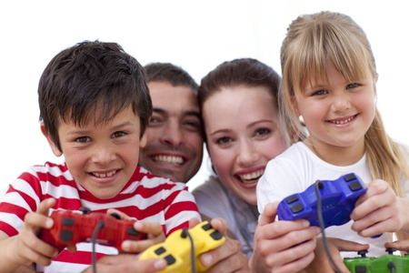 kids playing video games: Portrait of family playing video games at home Stock Photo