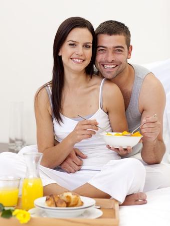 roomservice: Couple having healthy breakfast in bed