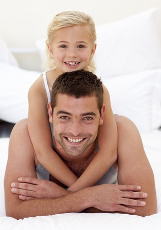 Father and daughter playing in bed Stock Photo - 10112056