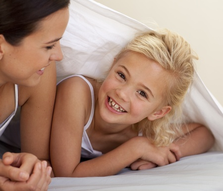bedsheets: Mother and daughter playing under the bedsheets