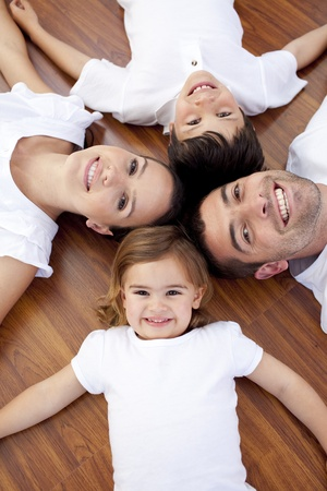 Family lying on floor with heads together photo
