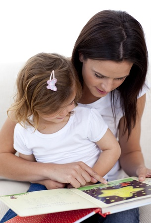 Mother and daughter reading a book Stock Photo - 10112093