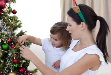 Mother and daughter decorating a Christmas tree photo