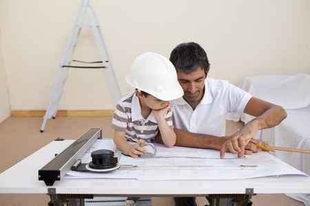 Father and son studying working with plans photo
