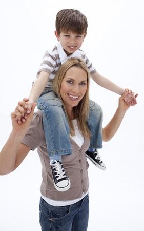 Woman giving little boy piggyback ride Stock Photo - 10112006