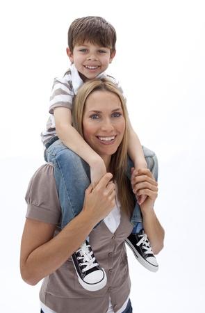 Mother giving son piggyback ride Stock Photo - 10110921