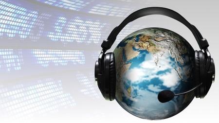 ear phones: Ear Phones and ear Piece around a Globe Stock Photo