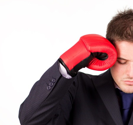 businessman with boxing gloves to his head photo