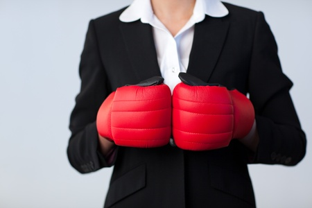 Business woman with boxing gloves on photo
