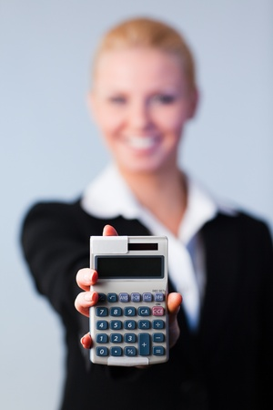 Business woman holding calculator photo