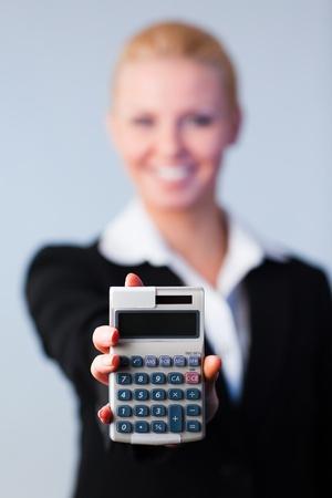 Business woman holding calculator photo