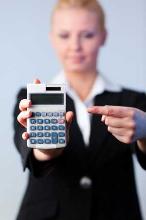 Business woman with a calculator Stock Photo - 10112510
