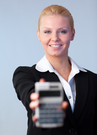 Business woman holding up a calculator photo