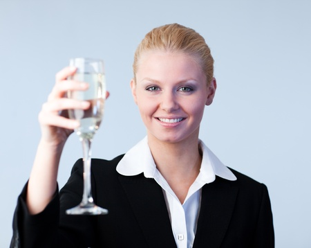 Business woman Holding a Champagne Glass Stock Photo - 10111717