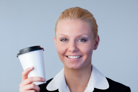 Businesswoman holding a coffee cup Stock Photo - 10112120