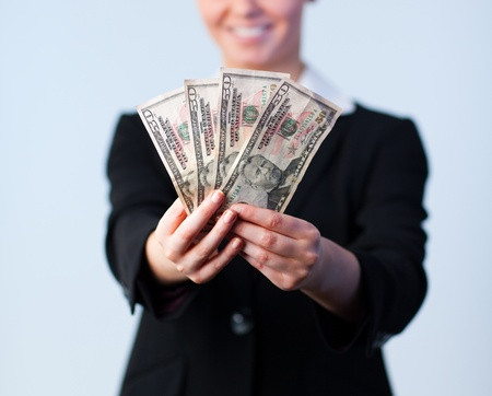Business woman holding up dollars Stock Photo - 10110118