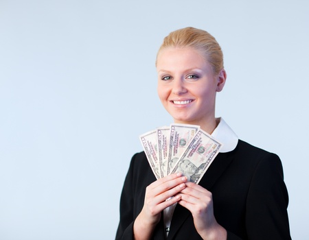 Business woman holding dollars up photo