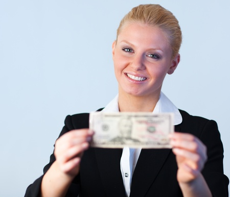 Business woman holding dollars to the camera photo