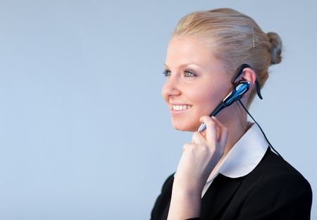 Attractive Business woman talking on a head piece photo