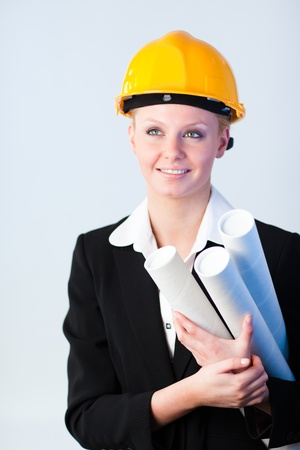 female constrcution worker with blueprints photo
