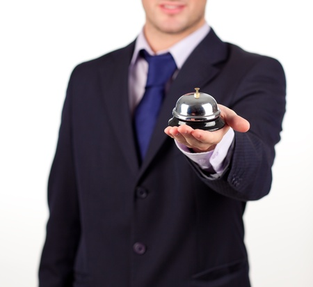 waiter holding a hotel bell photo