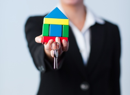 Woman holding house and dollars photo