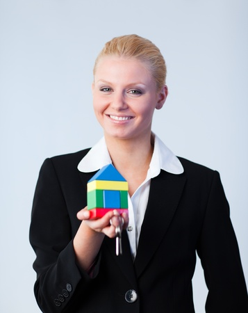 Woman holding a house photo