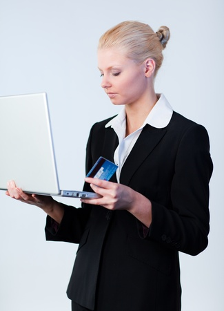 Woman with a credit card and laptop photo