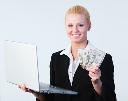 woman holding dollars and a laptop Stock Photo - 10109656