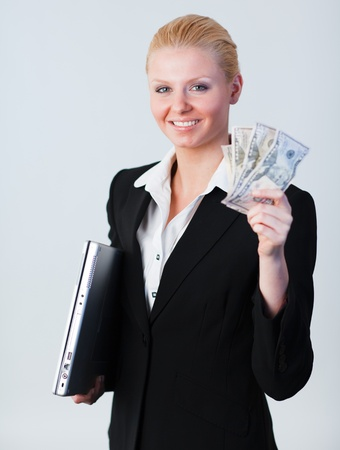 woman holding dollars and a laptop photo