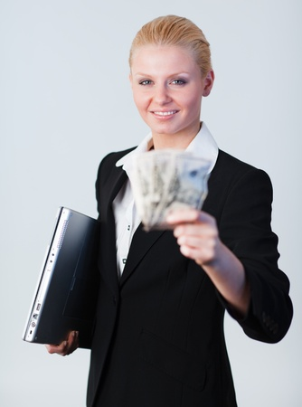woman holding dollars and a laptop Stock Photo - 10111502