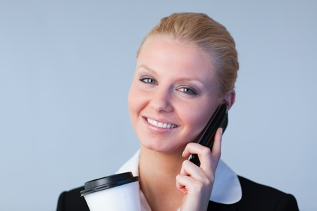 Pretty woman talking on the phone holding photo